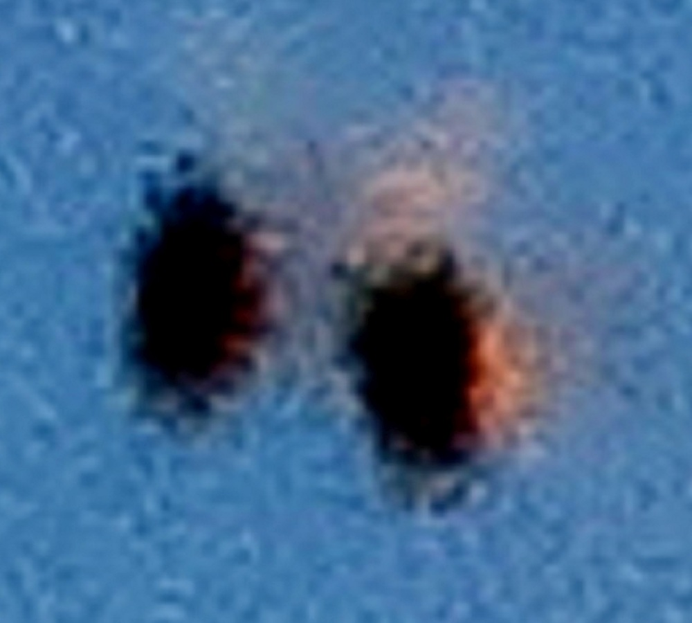 Two unknowns flying side-by-side; image cropped and enlarged